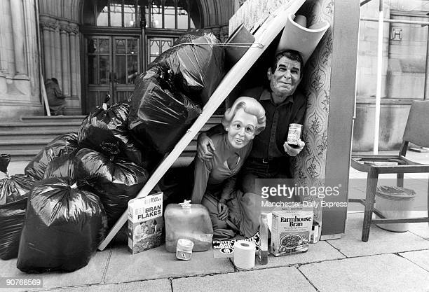 Protestors dressed as British Prime Minister Margaret Thatcher and US President Ronald Reagan in a makeshift nuclear fallout shelter outside...