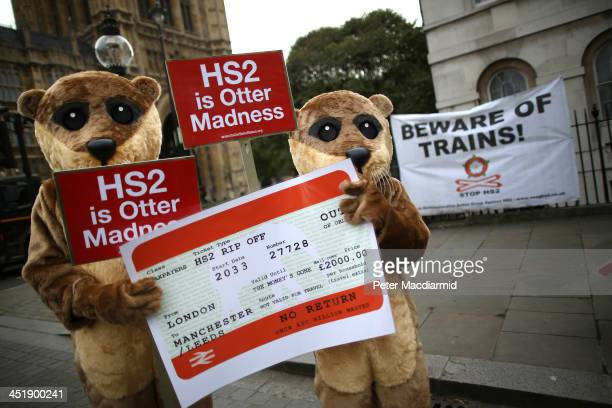 Protestors dressed as otters demonstrating against the High Speed 2 rail line gather near Parliament on November 25 2013 in London England...