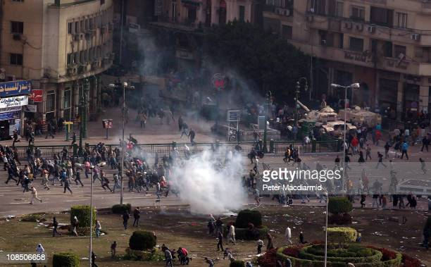 Protestors flee a volley tear gas in Tarhir Square on January 29 2011 in Cairo Egypt Tens of thousands of demonstrators have taken to the streets...