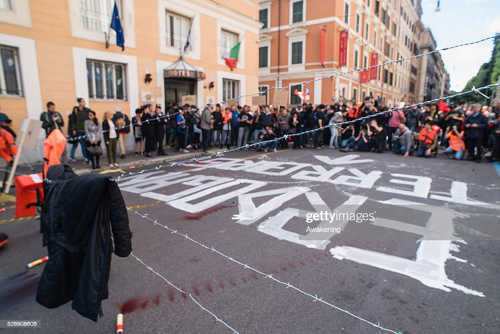 Protestors form a barrier with barbed wire during May Day protests on May 01, 2016 in Rome, Italy. Police clashed with protestors as hundreds took to the streets to participate in May Day marches and gatherings across Italy, with may demonstrators demanding a solution to the migrant crisis.
