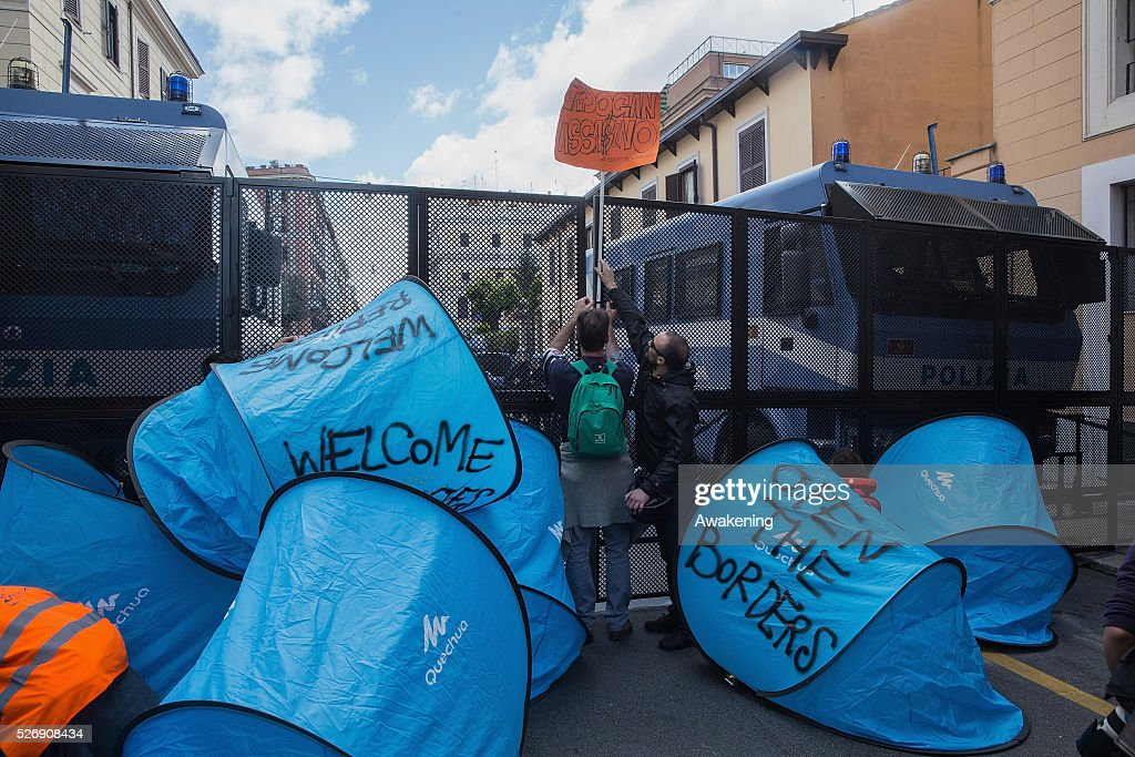 Protestors form a barrier with tents and barbed wire during May Day protests on May 01, 2016 in Rome, Italy. Police clashed with protestors as hundreds took to the streets to participate in May Day marches and gatherings across Italy, with many demonstrators demanding a solution to the migrant crisis.