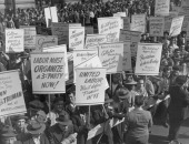 Protestors from labour unions demonstrating against President Harry S Truman's threat to draft striking workers into the armed forces New York City...
