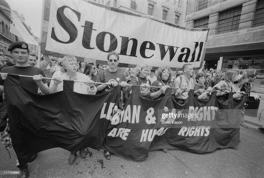Protestors from lesbian gay and bisexual rights charity Stonewall carrying a banner reading 'Lesbian Gay Rights are Human Rights' during the Gay...