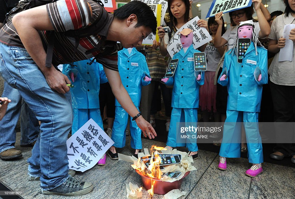 Protestors from SACOM (Students and Scholars Against Corporate Misbehaviour) burn effigies of Apple products during a demonstration near the offices of Foxconn in Hong Kong on May 25, 2010. The founder of Taiwan's Foxconn Group on Monday broke his silence over a string of suicides by its employees in China, denying the deaths were related to conditions at the technology giant's factories.