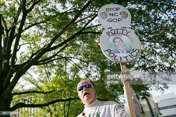 STATES MAY 16 Protestors gather across the street from the North Carolina state legislative building as they voice their concerns over House Bill 2...
