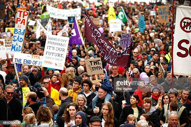 Protestors gather around the US Embassy following a protest march down Queen Street on August 15 2015 in Auckland New Zealand The TransPacific...