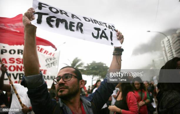 Protestors gather at a demonstration calling for the ouster of President Michel Temer on May 21 2017 in Rio de Janeiro Brazil Protests were held...