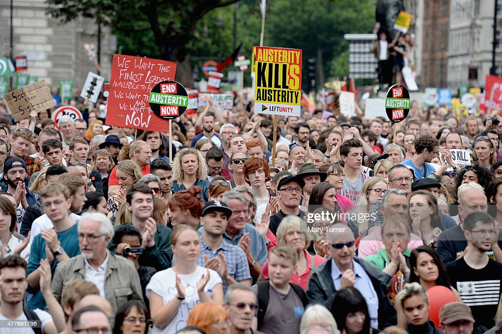 Protestors gather in Parliament Square to protest against austerity and spending cuts on June 20 2015 in London England Thousands of people gathered...