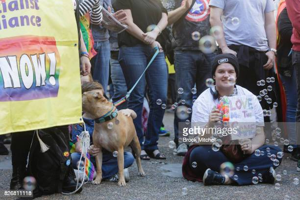 Protestors gather in support of efforts to leagalise same sex marriage at Sydney Town Hall on August 6 2017 in Sydney Australia The federal...