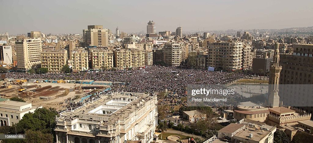 Protestors gather in Tahrir Square on February 1, 2011 in Cairo, Egypt. The Egyptian army has said it will not fire on protestors as they gather in large numbers in central Cairo demanding the resignation of Egyptian President Hosni Mubare.