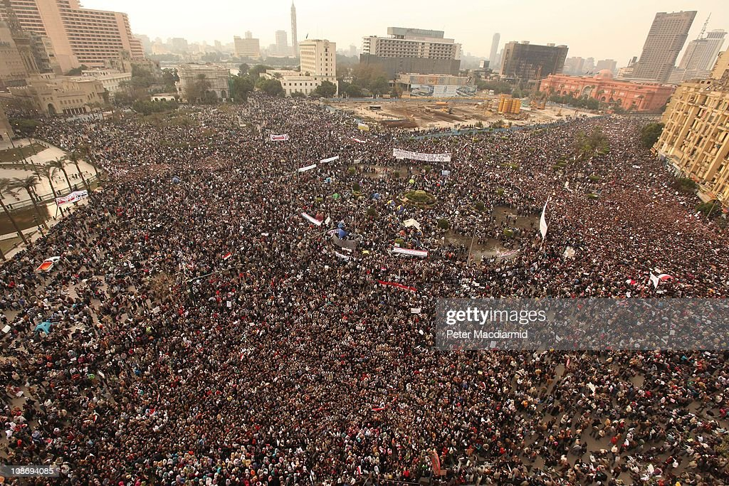 Protestors gather in Tahrir Square on February 1, 2011 in Cairo, Egypt. Protests in Egypt continued with the largest gathering yet, with many tens of thousands assembling in central Cairo, demanding the ouster of Egyptian President Hosni Mubarak. The Egyptian army has said it will not fire on protestors as they gather in large numbers in central Cairo.