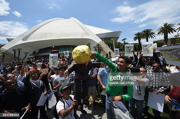 Protestors gather outside the Anaheim Convention Center with an effigy of Donald Trump prior to a rally for the Republican presidential candidate on...