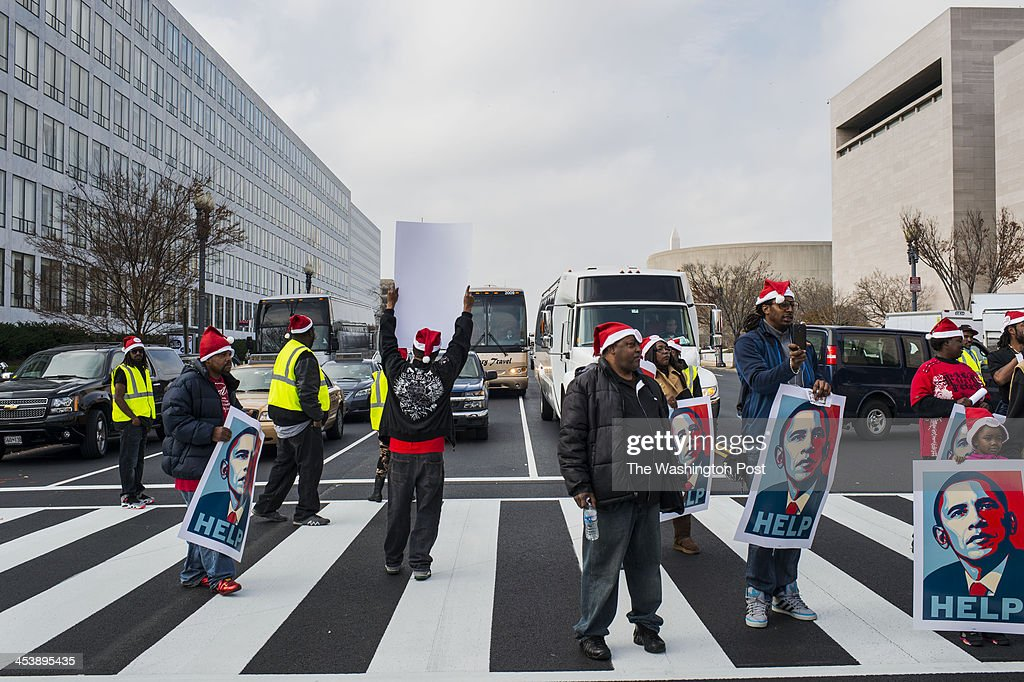 Protestors gather outside the Smithsonian Air and Space Museum in support of better pay wages for D.C. workers under a federal contract at McDonalds's and other fast food chains on Thursday, December 5, 2013.