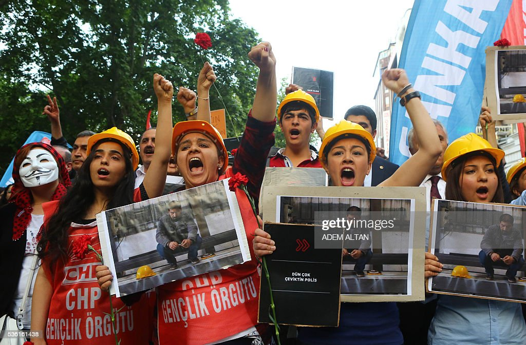 Protestors gesture and shout slogans on May 31, 2016 in Ankara during a demonstration commemorating the third anniversary of the start of the Gezi Park protests. The Gezi Park protests which began in May 2013, were sparked by the heavy-handed eviction of demonstrators staging a sit-in protest against the redevelopment of the area and grew into often violent clashes with police as people demonstrated against much broader issues concerning perceived infringements of civil rights. / AFP / ADEM