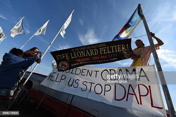 Protestors hang signs against the Dakota Access Pipeline at the protest camp near Cannon Ball North Dakota on September 3 2016 The Indian reservation...