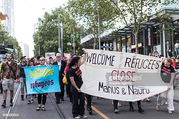 Protestors hold a banners outside the state library building during a rally organized after the Australian High Court had rejected a challenge to the...