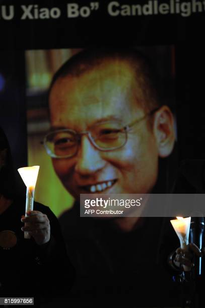 Protestors hold a candlelight vigil for the release of Chinese dissident Liu Xiaobo outside the Legislative Council building in Hong Kong on November...