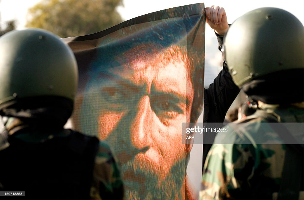 Protestors hold a poster featuring Georges Abdallah during a demonstration to call for his release outside the United Nations Interim Force in Lebanon (UNIFIL) French base on January 19, 2013 in the southern city of Deir Kifa. George Ibrahim Abdallah was sentenced to life imprisonment in France in 1984 for his part in the 1982 murders of two diplomats, Charles Robert Day, an American and Yacov Barsimantov, an Israeli, in Paris.