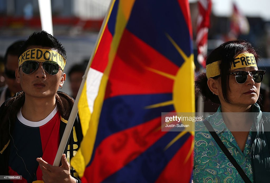 Protestors hold a Tibetan flag during a demonstration outside of San Francisco City Hall on March 10, 2014 in San Francisco, California. Hundreds of activists marked the 55th anniversary of the 1959 Tibetan uprising and the fifth anniversary of Tibetan self-immolation protests in Tibet.