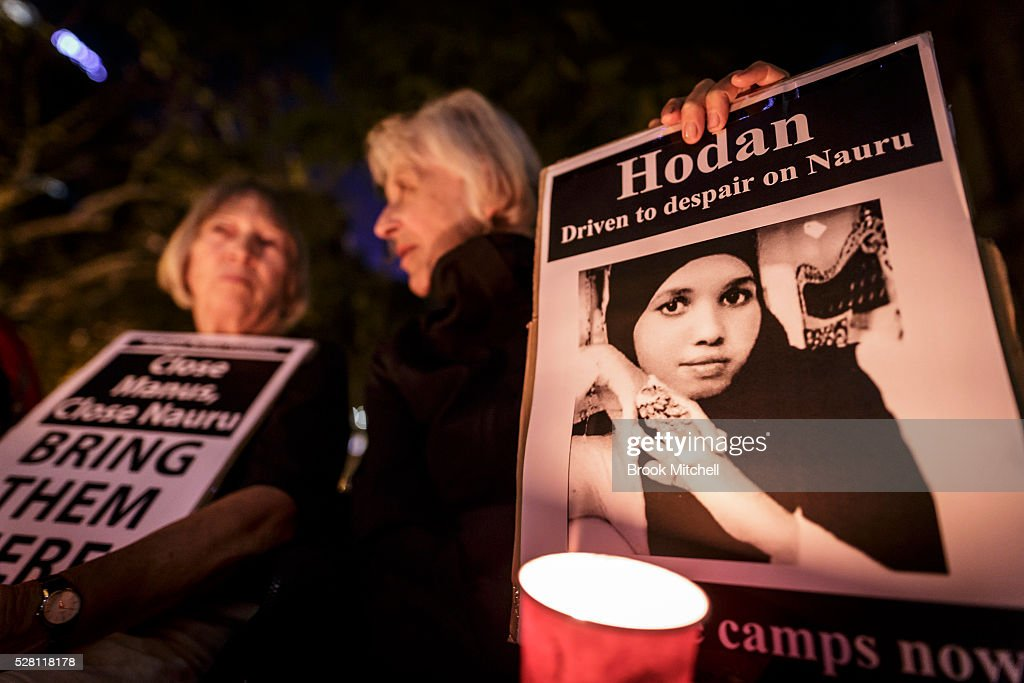 Protestors hold a vigil at Sydney Town Hall on May 4, 2016 in Sydney, Australia. Hodan Yasin, a 21-year-old Somali refugee is being treated in a Brisbane hospital after setting herself alight in detention on Nauru on Monday. It is the second attempt on Nauru in a week, after Iranian refugee Omid Masoumali set himself on fire last Wednesday. He later died from his injuries.