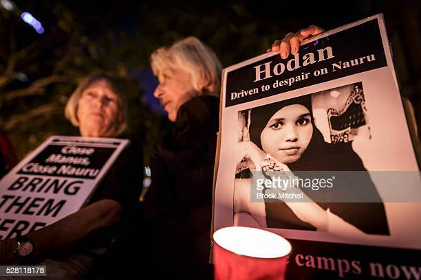 Protestors hold a vigil at Sydney Town Hall on May 4 2016 in Sydney Australia Hodan Yasin a 21yearold Somali refugee is being treated in a Brisbane...