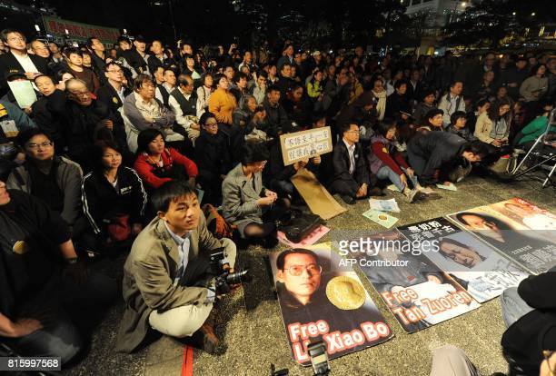 Protestors hold a vigil for Nobel winner Liu Xiaobo in Hong Kong on December 10 2009 China clamped down on dissidents the Internet and the media as...