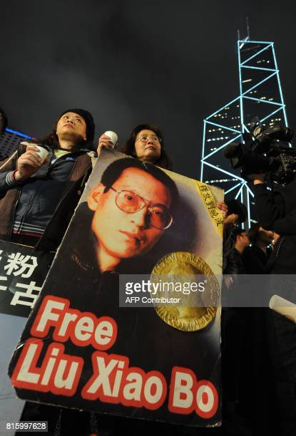 Protestors hold a vigil for Nobel winner Liu Xiaobo in Hong Kong on December 10 2010 China clamped down on dissidents the Internet and the media as...