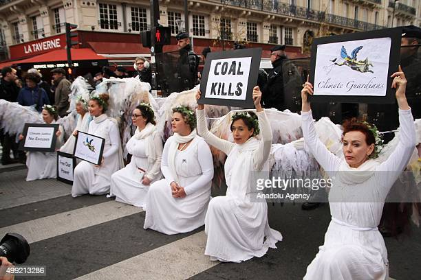 Protestors hold banners as they participate in the human chain demonstration at Republique Square ahead of the UN climate change conference in Paris...