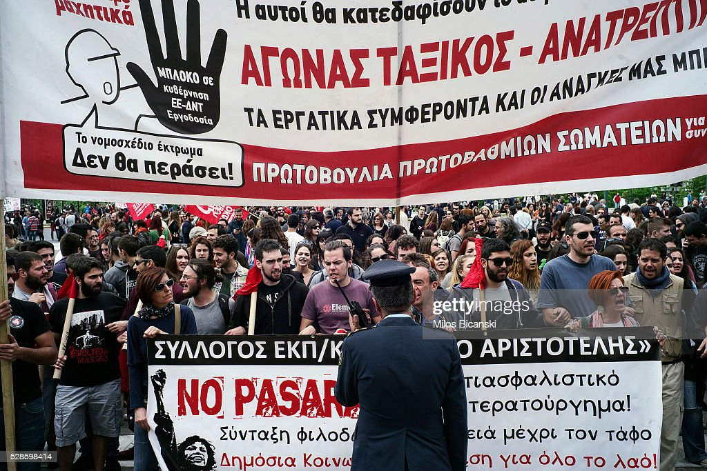 Protestors hold banners during a 48-hour nationwide general strike on May 6, 2016 in Athens, Greece. Unions called the strike to protest against pension reforms that are part of Greece's third international bailout.