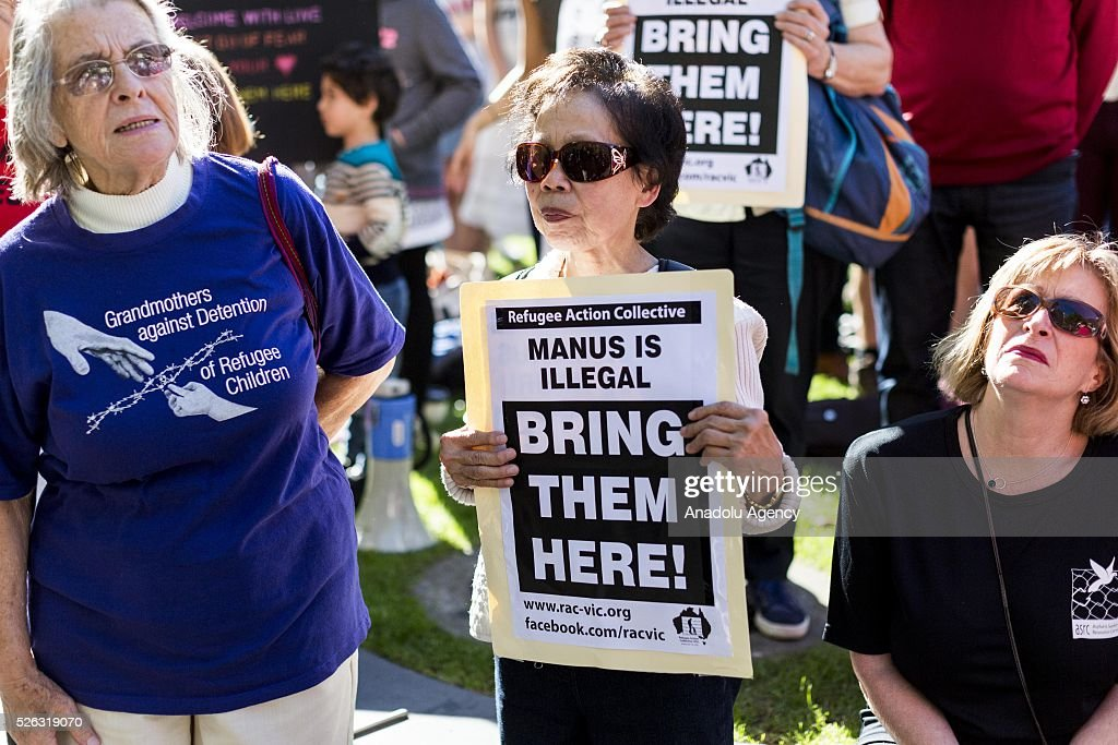 Protestors hold banners during a protest demanding that asylum seekers held in off shore detention to be brought to Australia at a rally in Melbourne, Australia on April 30, 2016. Protests have started after The Papua New Guinean Supreme Court ruled that the Australian-run detention centres on Manus Island were illegal and unconstitutional.