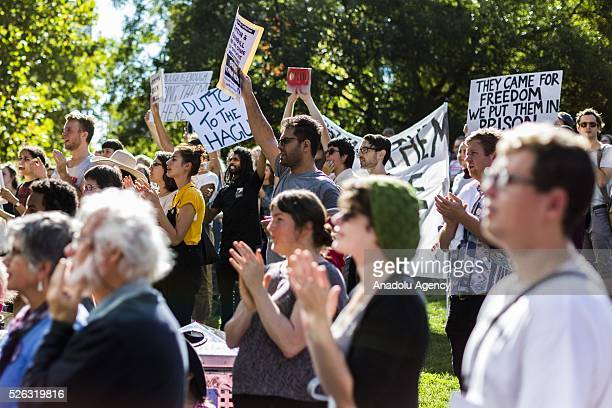 Protestors hold banners during a protest demanding that asylum seekers held in off shore detention to be brought to Australia at a rally in Melbourne...