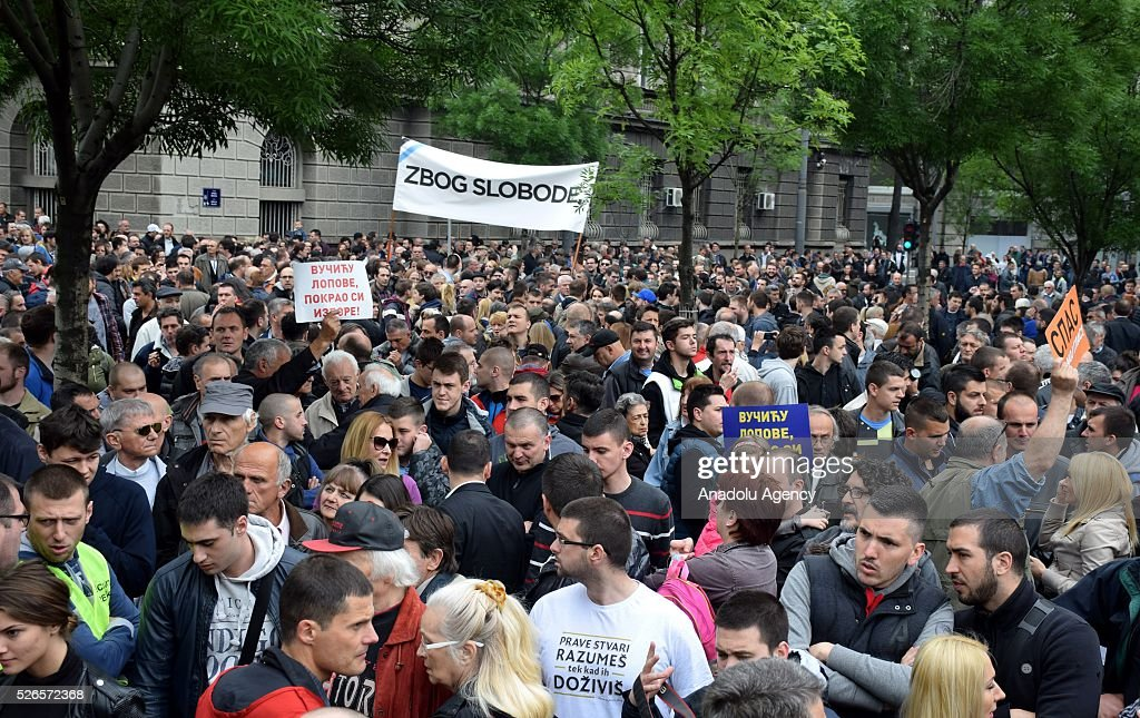 Protestors hold banners in front of the Electoral Commission during a protest organised by Serbian main opposition parties against alleged electoral 'fraud' at last weekend polls in downtown Belgrade, Serbia on April 30, 2016.