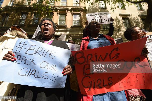Protestors hold placards as they demonstrate outside Nigeria House in central London on May 9 to demand the return of more than 200 Nigerian...