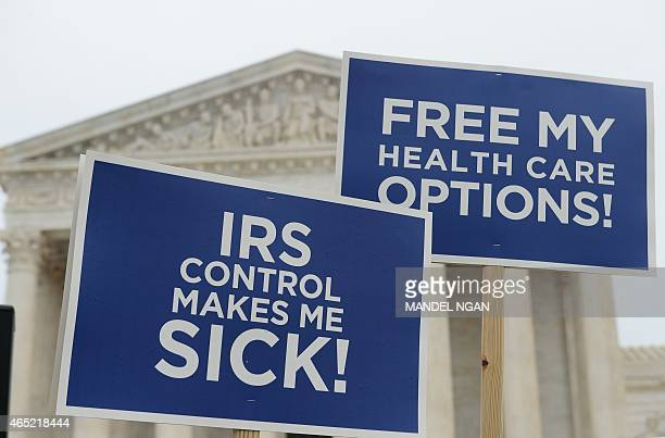 Protestors hold placards challenging 'Obamacare' outside of the US Supreme Court on March 4 2015 in Washington DC The US Supreme Court heard a second...