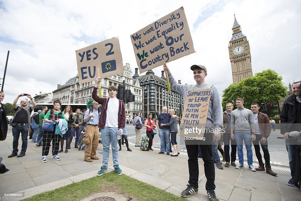 Protestors hold placards to demonstrate against the European Union (EU) referendum result, outside The Houses of Parliament in London, U.K., on Saturday, June 25, 2016. The U.K. voted to quit the European Union after more than four decades in a stunning rejection of the continent's postwar political and economic order. Photographer: Jason Alden/Bloomberg via Getty Images