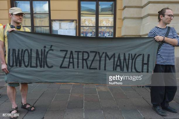 Protestors hold 'Release Imprisoned' sign during 'Krakow in Solidarity with All Imprisoned in Hamburg' protest in front of the German Consulate in...