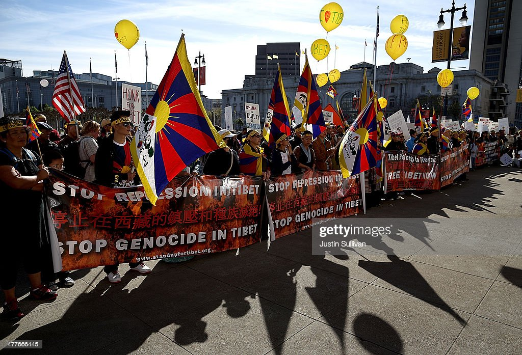 Protestors hold signs and Tibetan flags during a demonstration outside of San Francisco City Hall on March 10, 2014 in San Francisco, California. Hundreds of activists marked the 55th anniversary of the 1959 Tibetan uprising and the fifth anniversary of Tibetan self-immolation protests in Tibet.