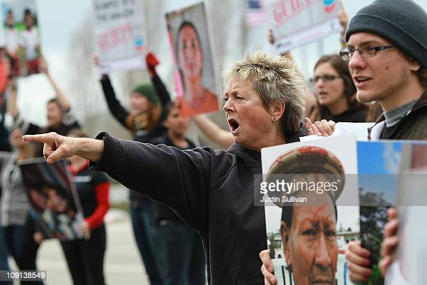 Protestors hold signs as the chant during a demonstration outside of the Chevron headquarters on February 15 2011 in San Ramon California Donzens of...