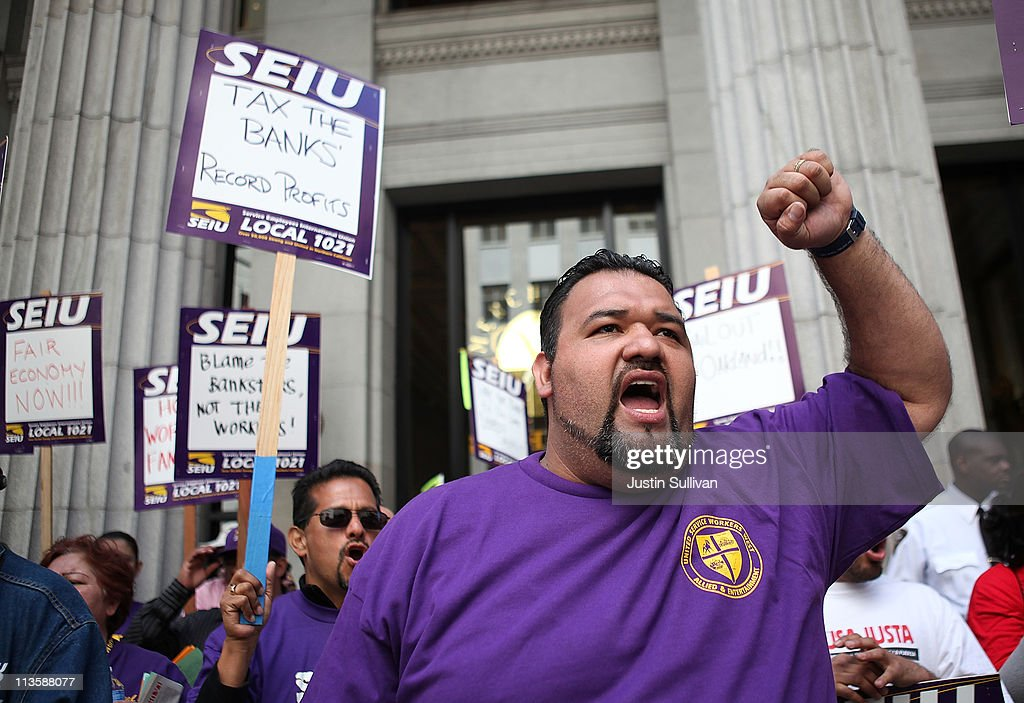 Protestors hold signs during a demonstration outside of the Wells Fargo shareholders meeting on May 3, 2011 in San Francisco, California. Over 100 housing activists staged a demonstration outside of the Wells Fargo shareholders meeting accusing the banking giant of predatory lending, not paying taxes and foreclosing on homes by using fradulent paperwork.