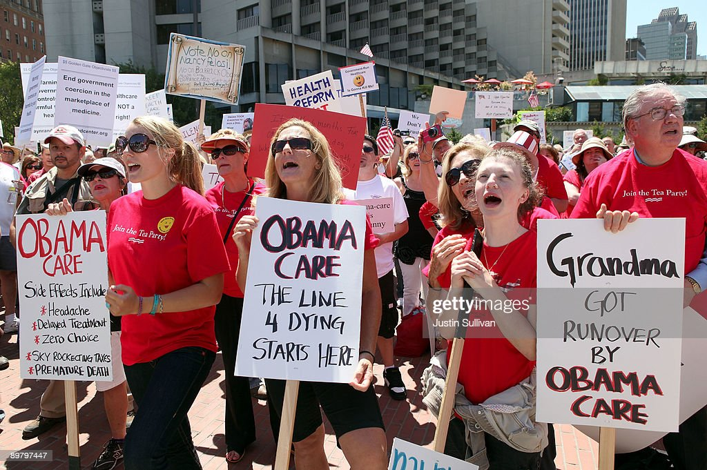 Protestors hold signs during an antihealth care reform rally August 14 2009 in San Francisco California As the national debate over proposed health...