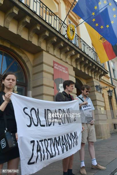 Protestors hold 'Solidarity with Imprisoned' sign during 'Krakow in Solidarity with All Imprisoned in Hamburg' protest in front of the German...