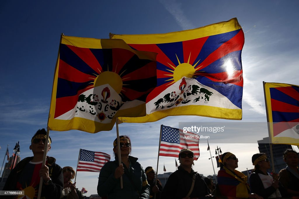 Protestors hold Tibetan flags during a demonstration outside of San Francisco City Hall on March 10, 2014 in San Francisco, California. Hundreds of activists marked the 55th anniversary of the 1959 Tibetan uprising and the fifth anniversary of Tibetan self-immolation protests in Tibet.