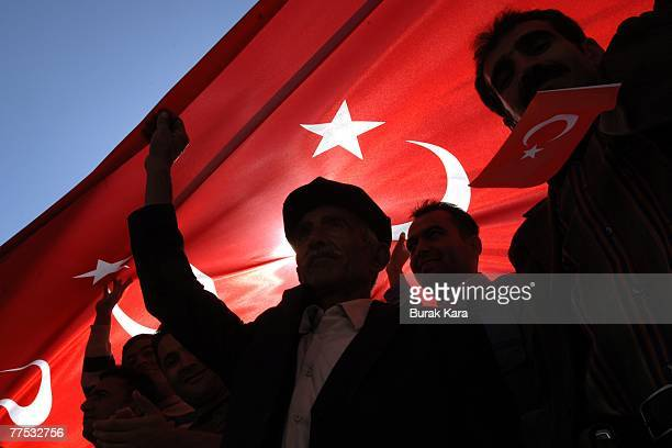 Protestors hold Turkish flags aloft and shout slogans against the outlawed Kurdistan Workers Party on October 27 2007 in dowtown Sirnak city Sirnak...