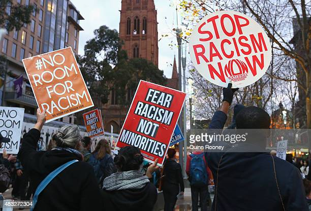 Protestors hold up signs at Melbourne City Square on August 7 2015 in Melbourne Australia The grassroots rally was organised by 'No Room for Racism'...