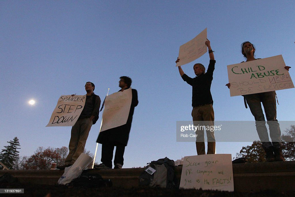 Protestors hold up signs outside the Administration building on the campus of Penn State University calling for the resignatation of the school's president on November 8, 2011 in State College, Pennsylvania.