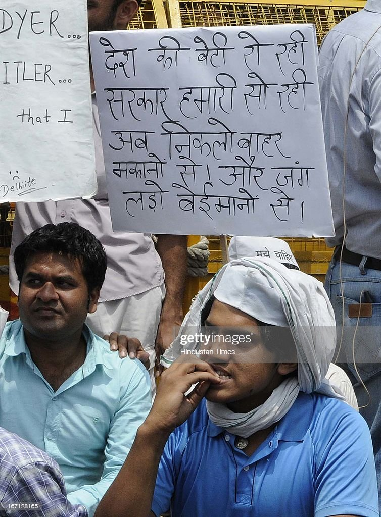 A protestors holding placard on alleged corruption in police during protest outside Delhi Police Head Quarter demanding resignation of police commissioner Neeraj Kumar after a brutal rape of 5 year old girl and alleged police insensitivity in dealing with it on April 21, 2013 in New Delhi, India. A five year girl went missing on April 15 and was found on April 17 in same building where she lives with her parents. She was found in serious condition after being brutally raped and tortured with slashed neck and bite marks on her body. The man who lives in that room was arrested in Bihar state on April 20.