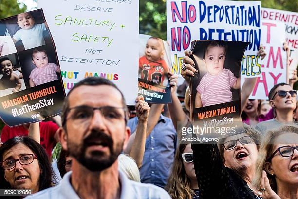 Protestors holding placards demand from the Australian government let refugees stay during a rally organised after the Australian High Court had...