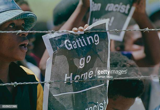 Protestors holding posters reading 'Gatting Go Home' during the controversial rebel tour of South Africa by the England cricket team 1990 Gatting is...