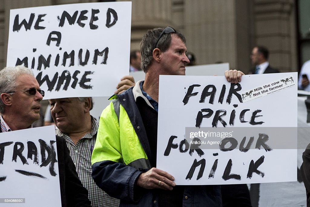 Protestors holds banners during a protest demanding Australian government to solve the dairy crisis in Melbourne, Australia on May 25, 2016.