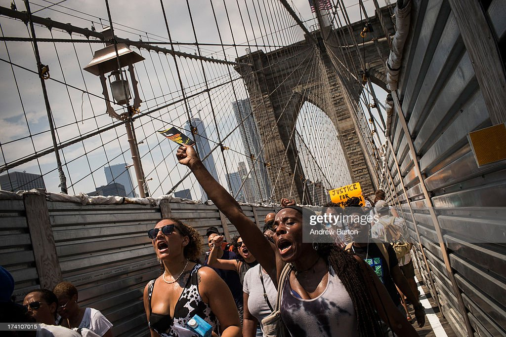 Protestors in support of Trayvon Martin march across the Brooklyn Bridge after attending a rally organized by the Reverand Al Sharpton in response to the non-guilty verdict for George Zimmerman on July 20, 2013 in New York City. In February 2012, Zimmerman shot and killed Trayvon Martin, a teenager, in Sanford, FL; he was found not guilty of murder due to Stand-Your-Ground laws. Protests have continued across the country since Zimmerman was found not guilty on July 13, 2013.